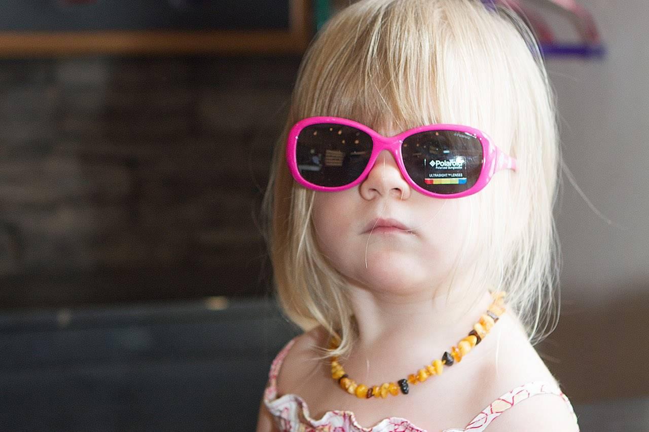 little girl blond pink sunglasses