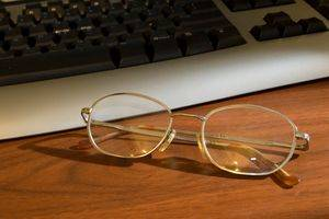 eyeglasses next to computer