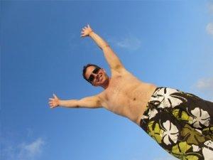 man reaching arms into sky