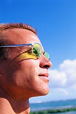 man wearing glasses in the sun
