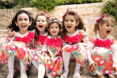 girls 20in 20flowered 20dresses 20being 20silly 20slide