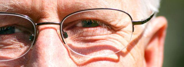 Senior man smiling before eye exam