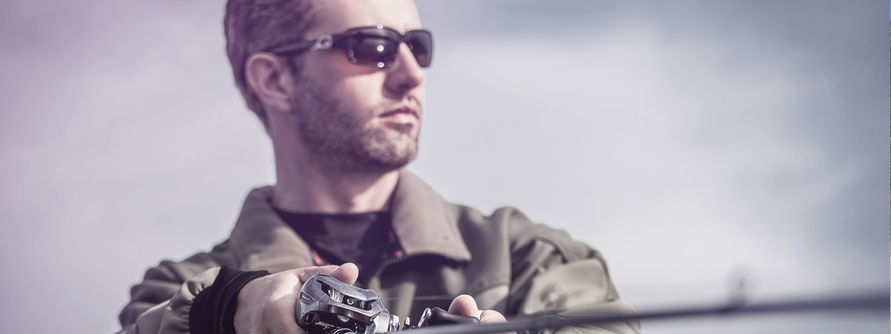 a man fishing rod sunglasses