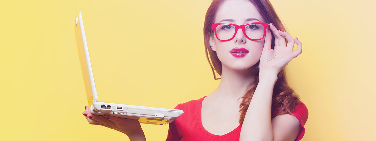 a-woman-holding-a-laptop-red-glasses