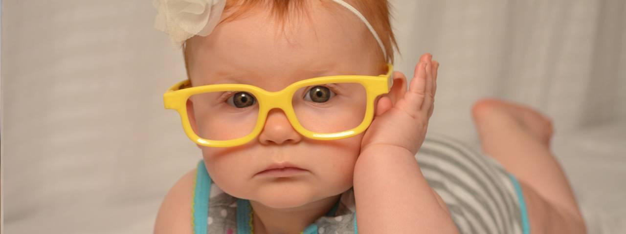 baby-girl-yellow-glasses-closeup-1280x480