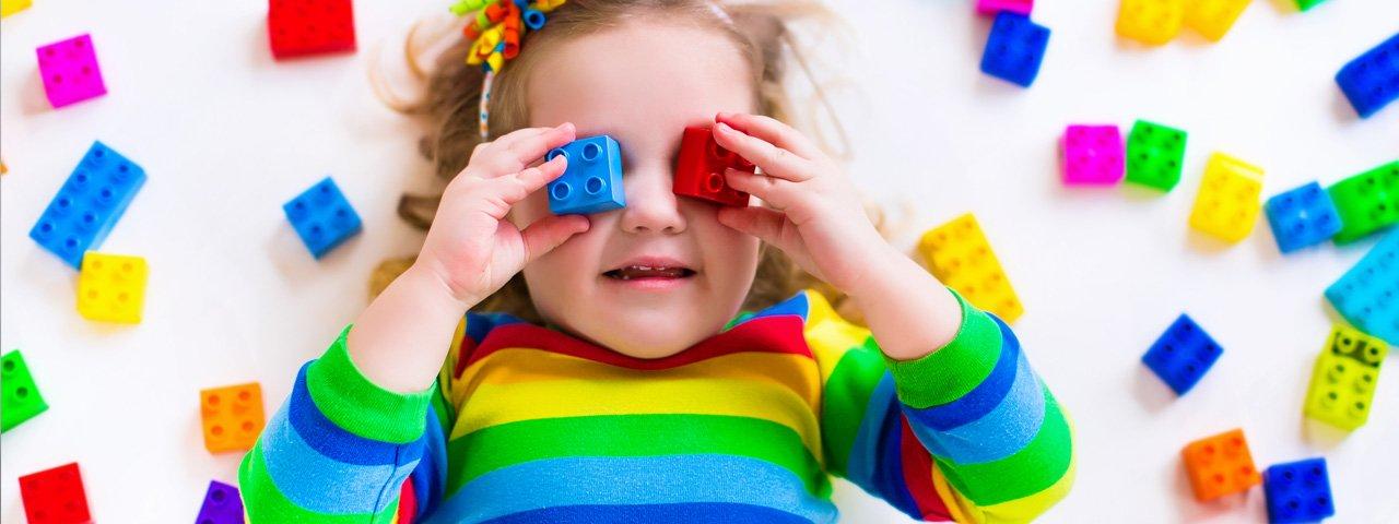 2yrs-child-girl-lego-eyes-colurful-1280x480