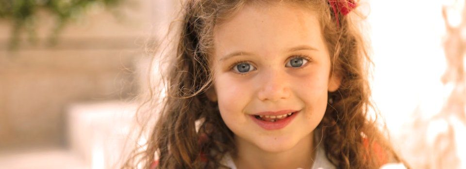 child%20with%20blong%20hair%20and%20blue%20eyes%20slide.png