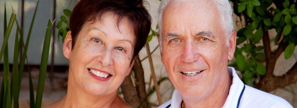 senior couple in white slide