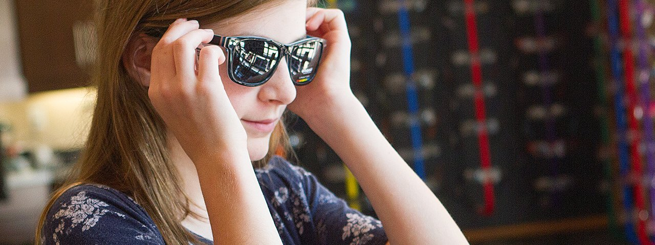 teenage-girl-trying-on-sunglasses1280x480